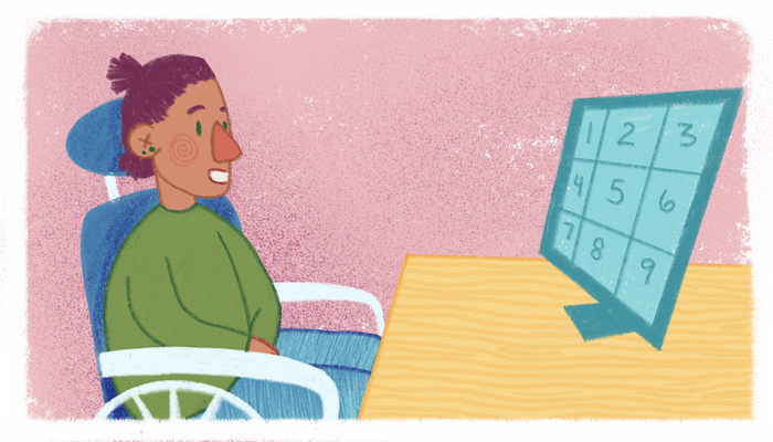 Pink background. Person in a wheelchair with headrest looking at screen on a desk with a grid of nine across it.